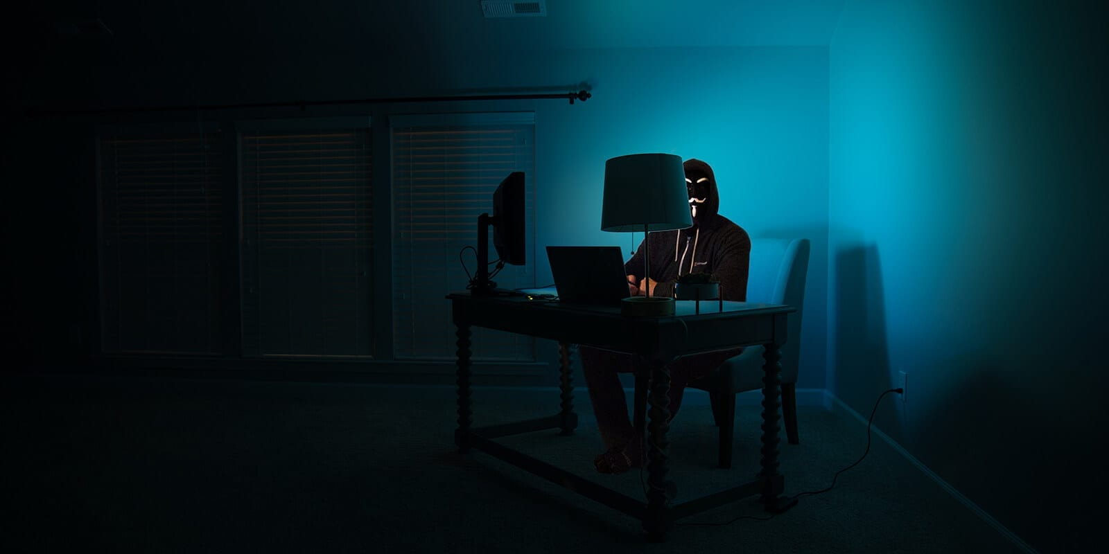 Man in the dark on computer - Password hacking
