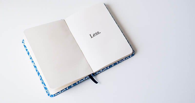 "Open notebook with the word ""Less"" typed on it"